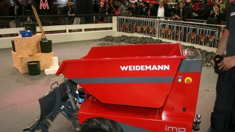 Rød dværgvogn viser fremtiden for staldarbejde