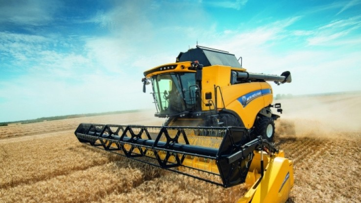 Ny tærskecylindre på gul maskine